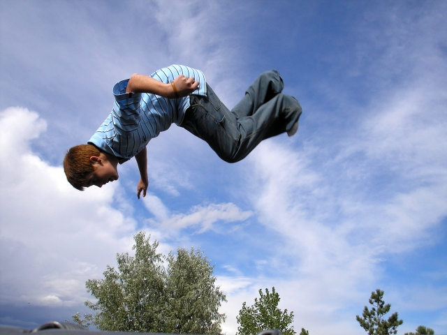 Boy flipping on a trampoline. Photograph by David Schauer