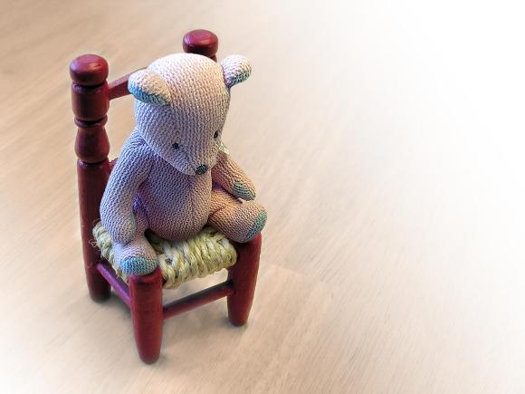 Teddy bear on chair. Photograph by brainloc