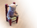 Teddy bear on chair. Photograph by brainloc