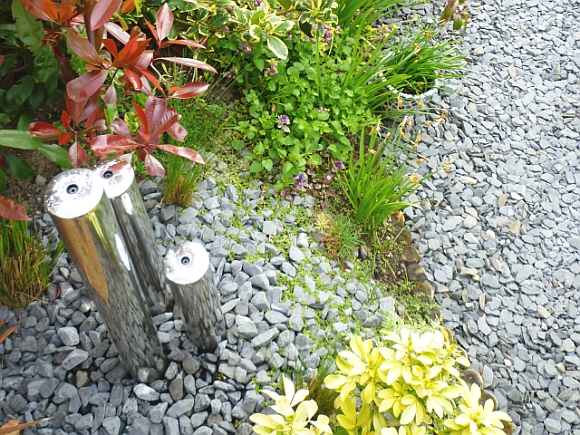 Garden and water feature. Photograph by Graham Soult