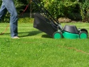 Person mowing a lawn. Photograph by Andrea Kratzenberg