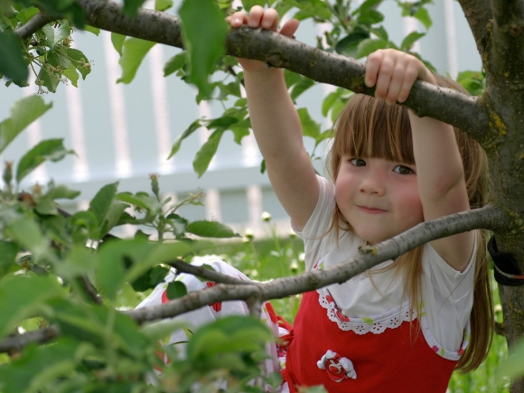 Child enjoying herself in the garden. Photograph by Armin Hanisch