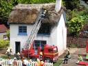 House on fire in a model village. Photograph by Chris Chidsey