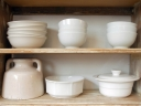 Crockery on shelves. Photograph by Dominic Morel