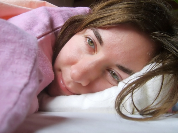 Woman in bed. Photograph by Dora Pete