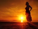 Girl on beach at sunset. Photograph by Lewy Ryan