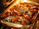 Potatoes and onions roasted in the oven. Photograph by Ariel da Silva Parreira