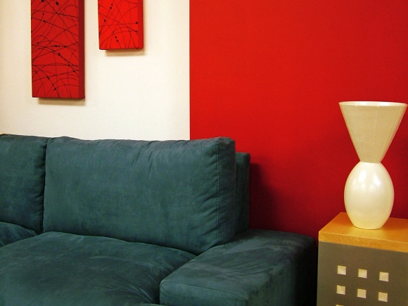 Sofa and feature wall. Photograph by Lotus Head