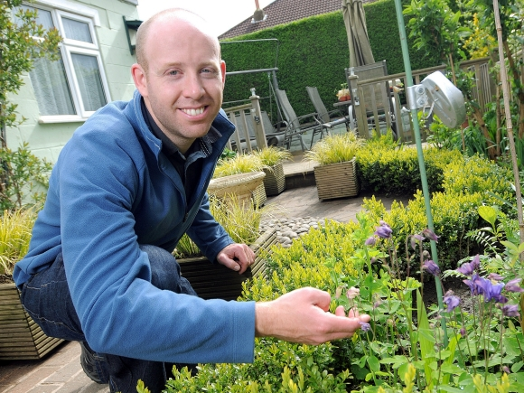 The University of Leeds' Dr Mark Goddard in an urban 'bee paradise'