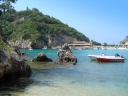 Boats and rocks in Paleokastritsa, Corfu. Photograph by Michaela Kobyakov
