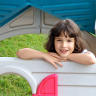 Vignette: Girl in playhouse. Photograph by Hector Landaeta